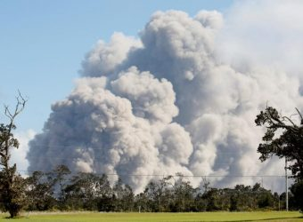 Ash erupts from Halemaumau Crater near the community of Volcano